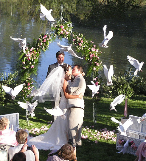 For an outdoor wedding releases are normally done at the end of the